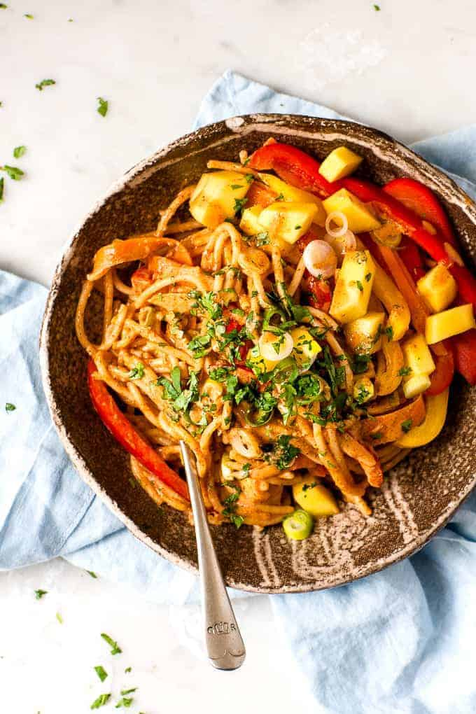 Chinese Noodles with Peanut Sauce in a Brown Bowl