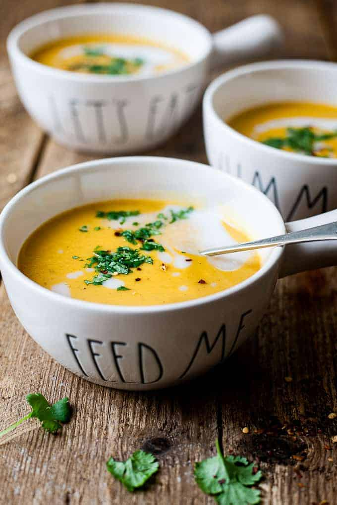 Creamy sweet potato squash soup in bowls all using Aldi ingredients.