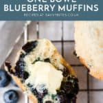 Blueberry muffin with butter on a cooling rack. With text overlay