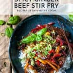 Ginger beef stir fry in a bowl with text overlay.
