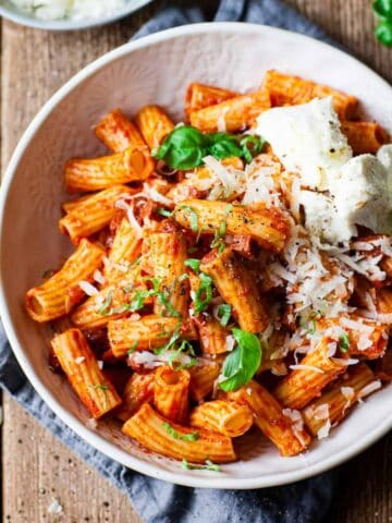 spicy chorizo pasta in a white bowl. All ingredients from Aldi.