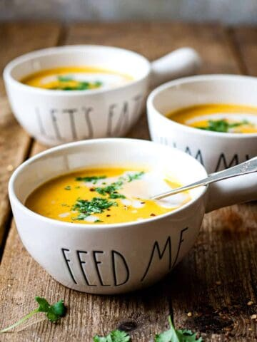 butternut squash sweet potato soup on a wooden table. Using Aldi Ingredients.