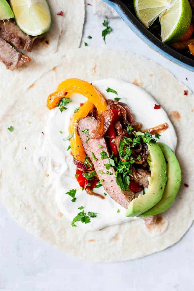 Close up steak fajita with peppers and avocado.