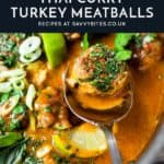 Turkey meatballs in a Thai curry sauce on a spoon with text overlay.