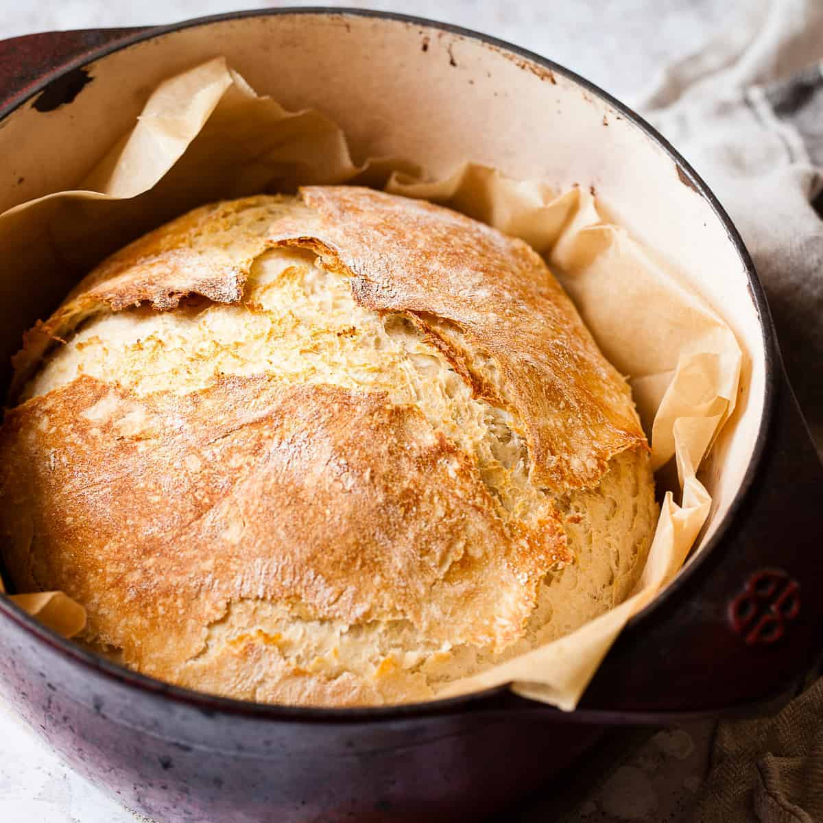 Basic bread in a Dutch oven made with Aldi ingredients.