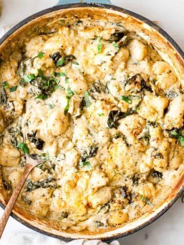 Artichoke and spinach gnocchi bake with pesto.
