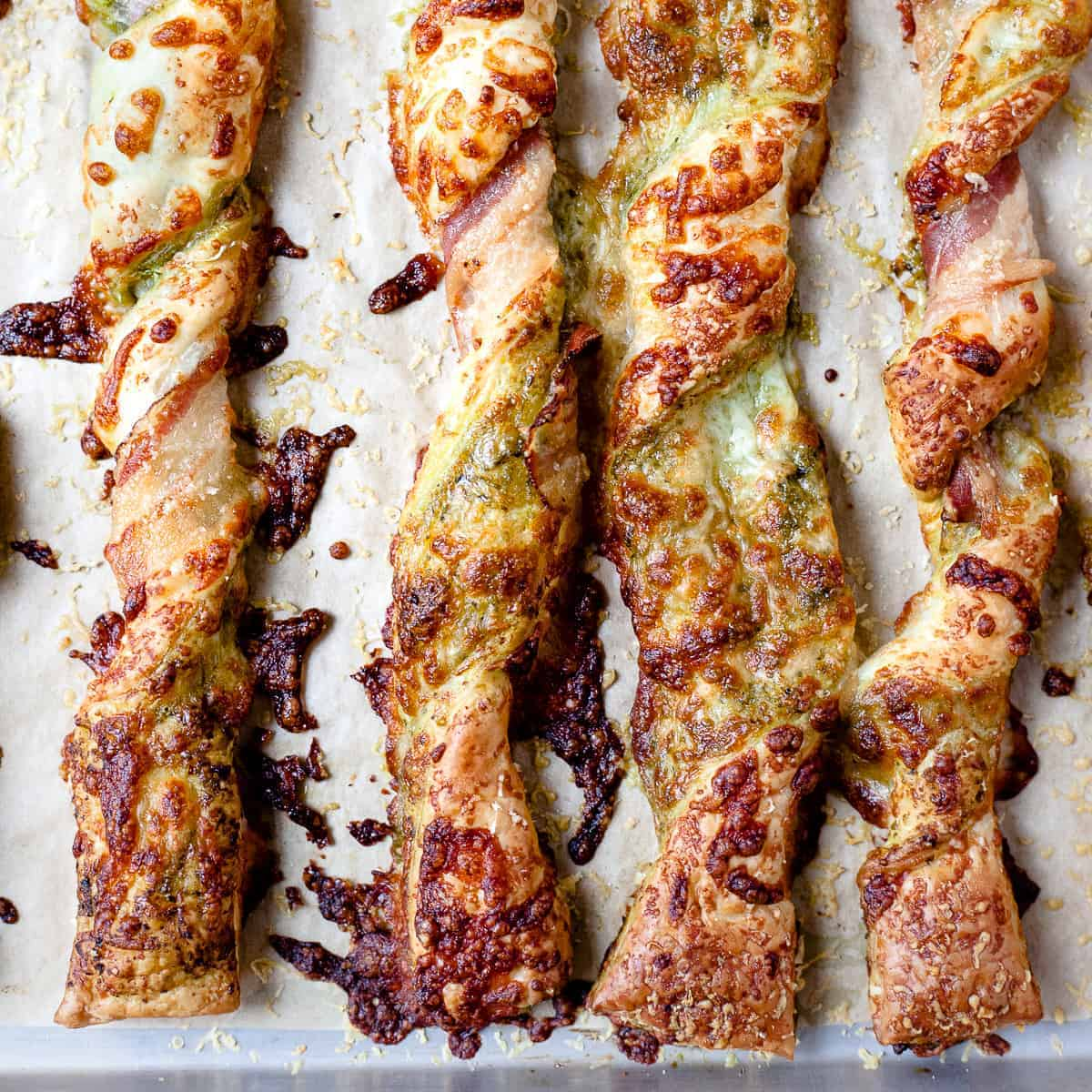 Cheese straws made using puff pastry and pesto. All ingredients from Aldi.