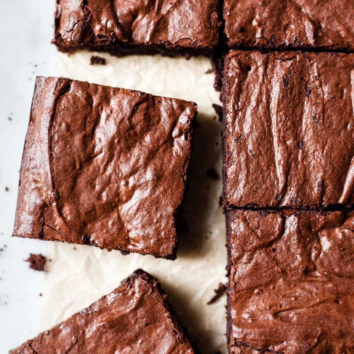 Chocolate brownies on a baking paper.
