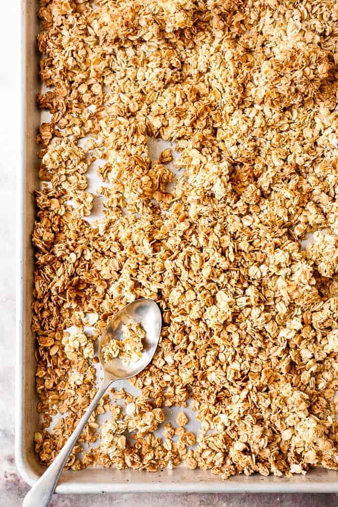 Homemade granola on a baking tray.