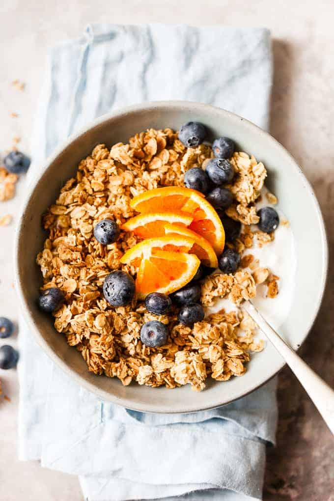 cluster maple granola in a blue bowl
