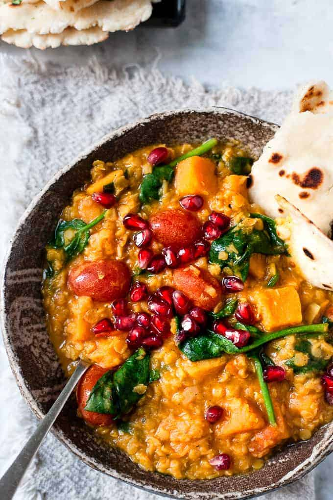 Butternut squash red lentil curry in a bowl with naan bread. Only using Aldi ingredients.