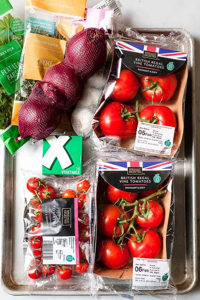 Aldi ingredients on a tray to make easy oven roasted tomato soup