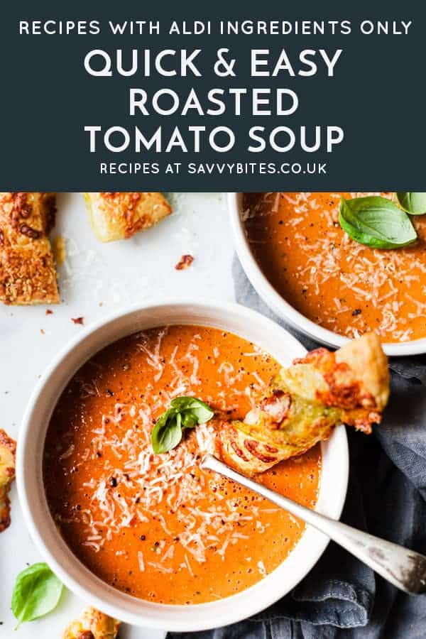 vegan roasted tomato soup with basil in a bowl with cheese bread.