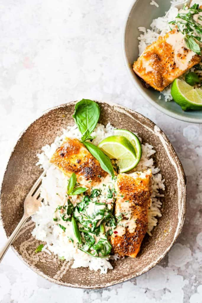 Creamy salmon curry in a bowl with rice. All Aldi ingredients.