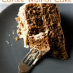 Slice of walnut and coffee cake with text overlay.