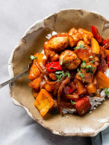 Bowl of sweet and sour chicken with rice.