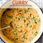 Vegan sweet potato curry in a blue pot.