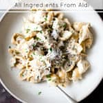 Aldi ingredients chicken and bacon pasta in a white bowl with a fork.