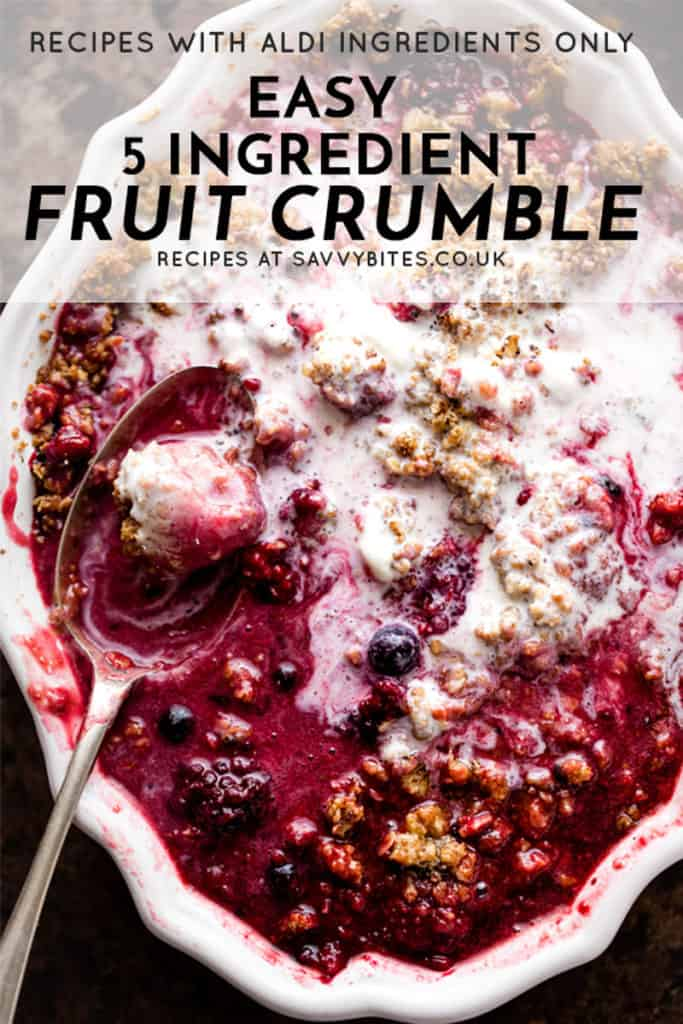 buttery oat topped fruit crumble with a spoon