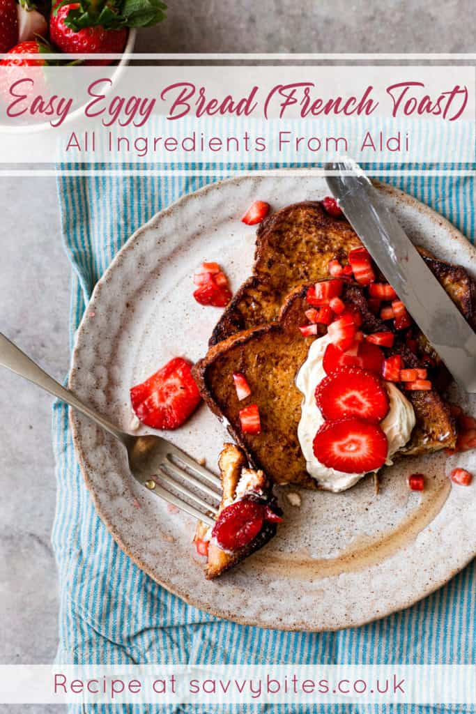 eggy bread with strawberries on a white plate with text overlay