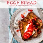 fluffy french toast eggy bread on a white plate with fork
