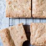 Blondies made with white chocolate on a cooling rack. Easy and chewy.