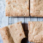 easy white chocolate blondies on a cooling rack with sea salt.