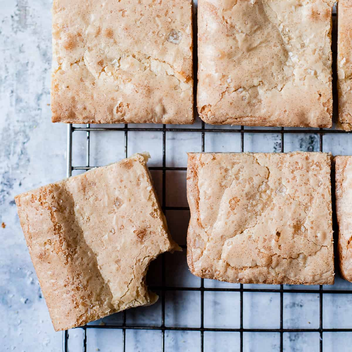 No fail white chocolate blondies on a cooling rack.