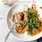 lamb curry in a white bowl with text overlay.