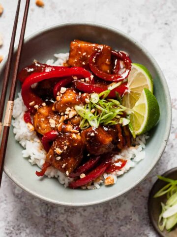 Sticky chicken using Aldi ingredients on a white table.