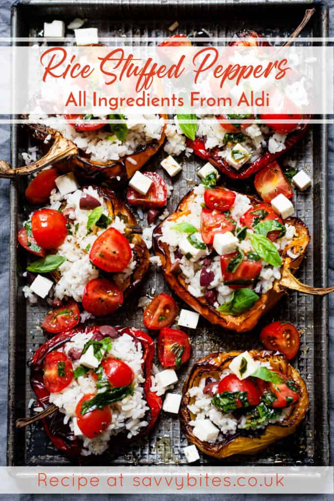 Rice stuffed peppers on a baking tray with text overlay. Aldi ingredients.
