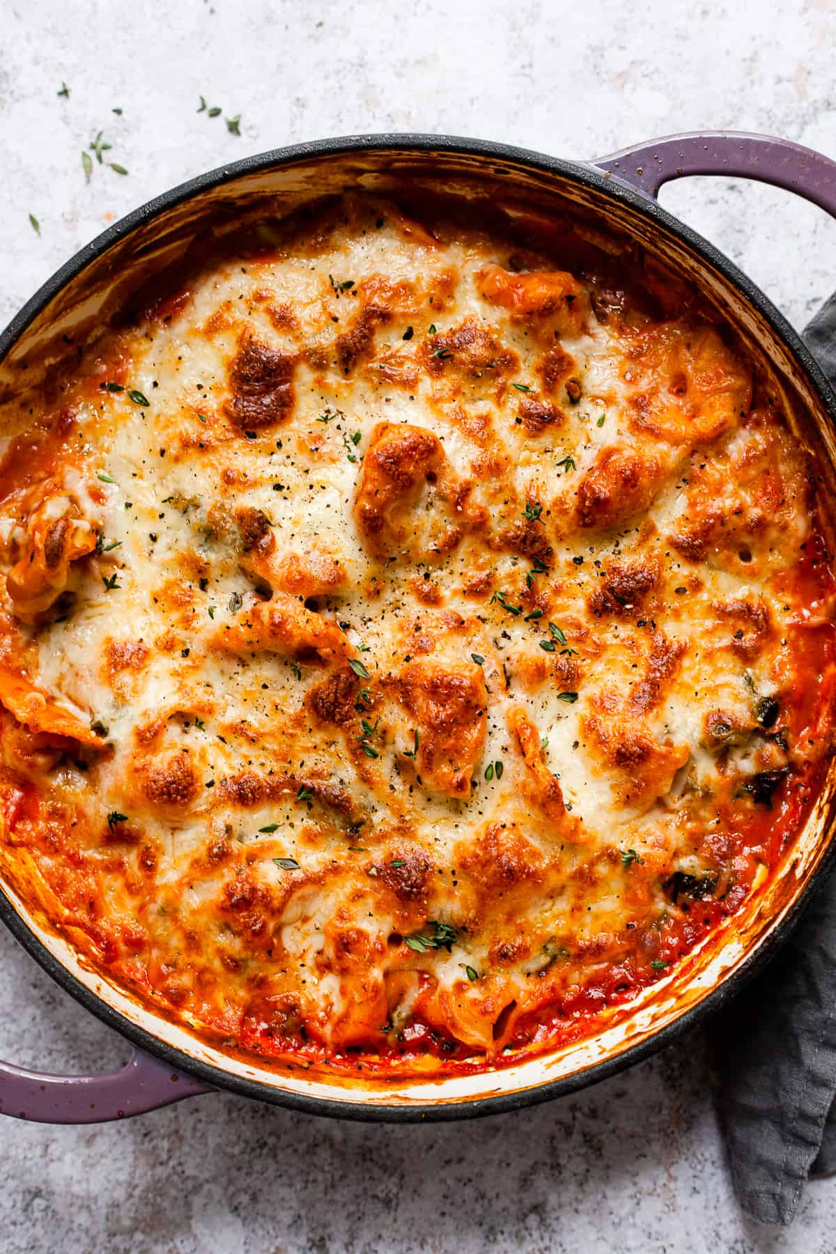 Baked tortellini with golden bubbling cheese. Aldi ingredients.