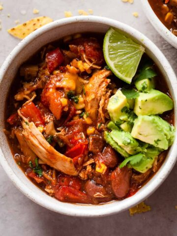 bowls of easy chicken chili on a white table