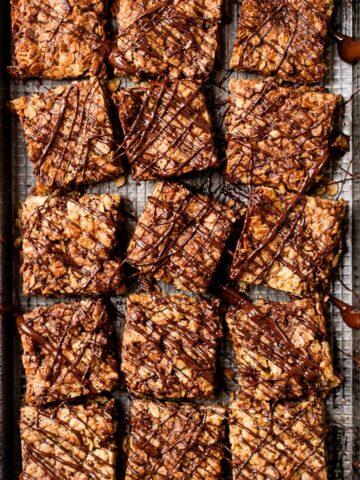 chocolate flapjacks on a black tray.