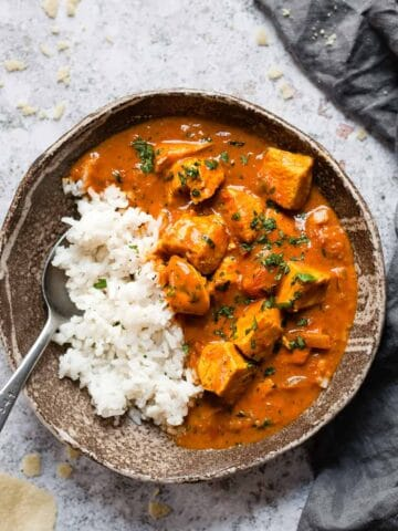 Easy coconut chicken curry in a brown bowl.