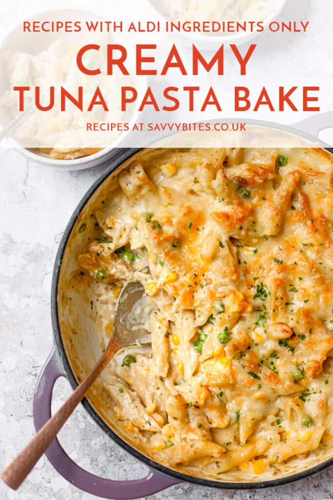 Creamy tuna pasta bake with a spoon in it and some text overlay.