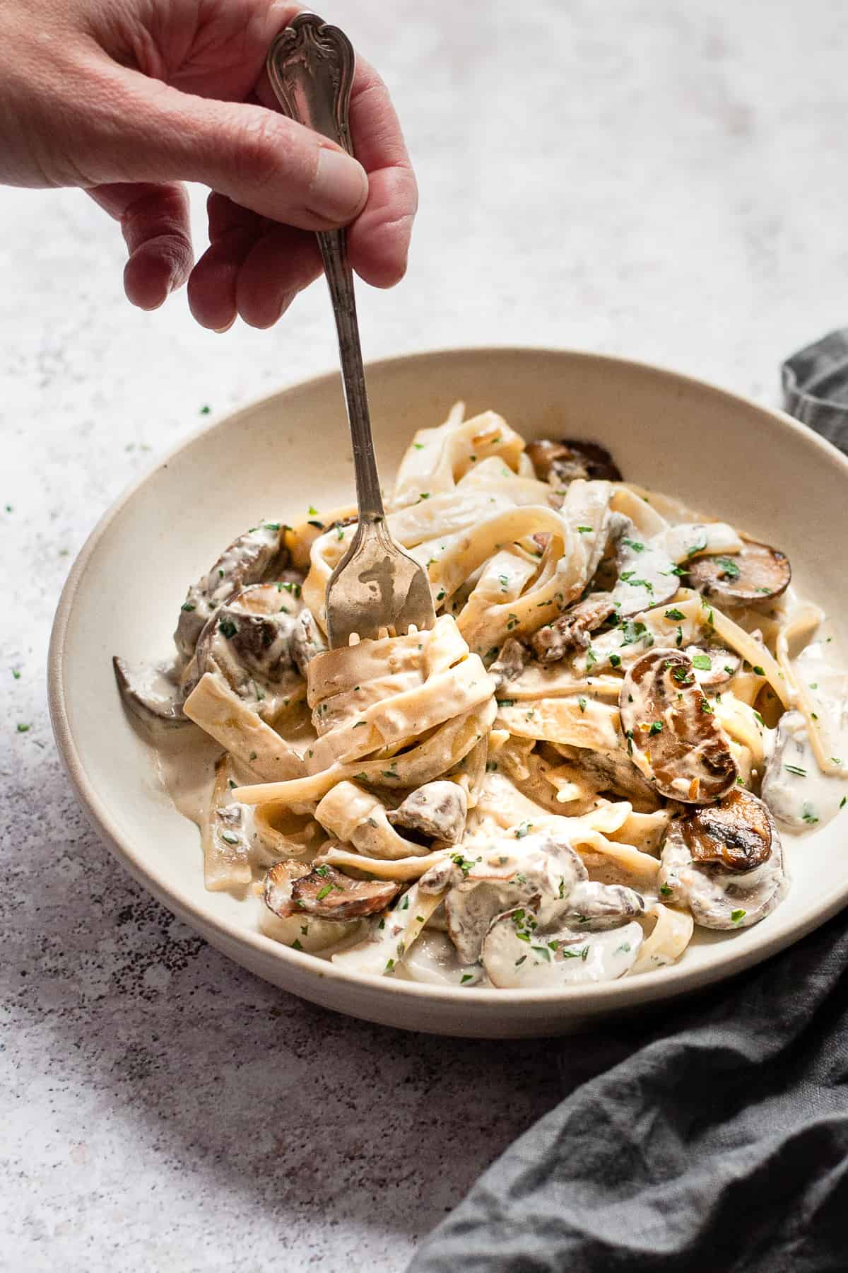 mushroom tagliatelle in garlic sauce in a white bowl. All Aldi ingredients.