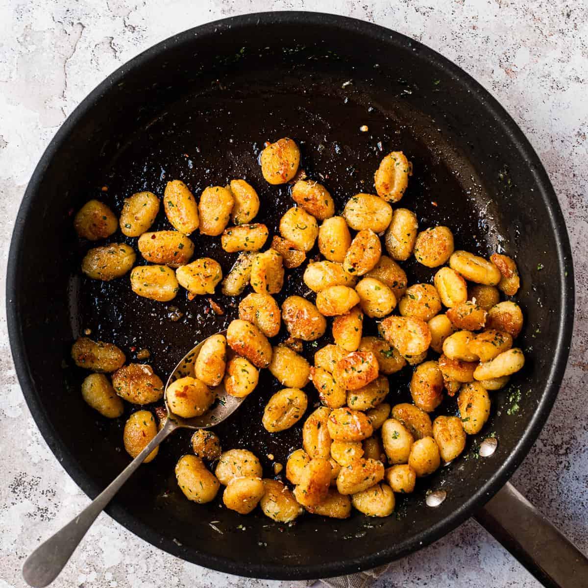 Pan fried gnocchi in a pan