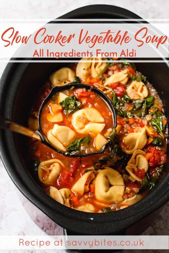 Vegetable Soup in a ladle with tortellini with text overlay.