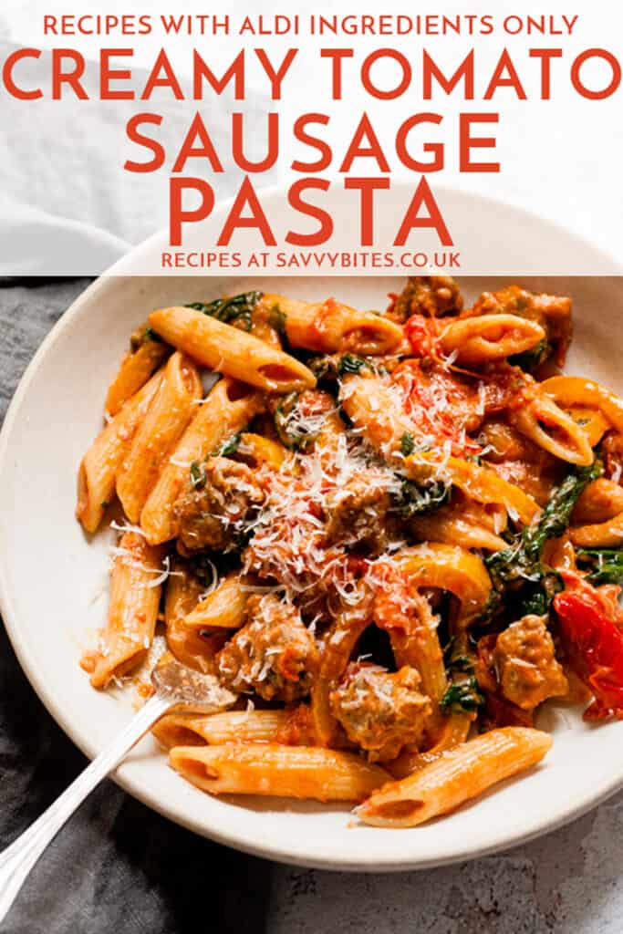 Sausage pasta in a pan with text overlay.