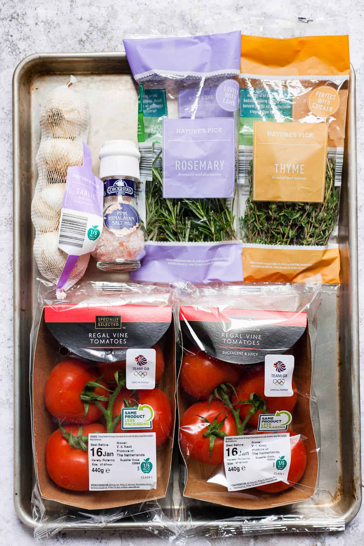 Ingredients from Aldi UK on a baking tray to make roasted tomatoes