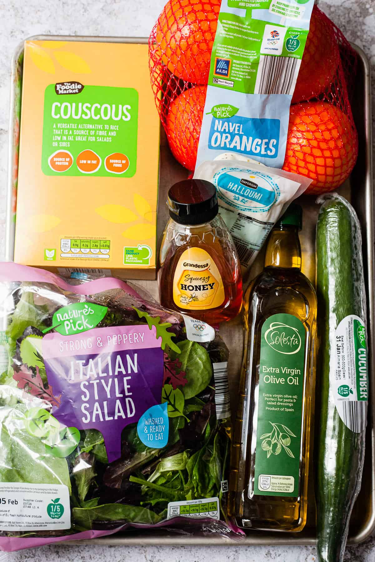 Ingredients from Aldi UK on a baking tray to make halloumi salad