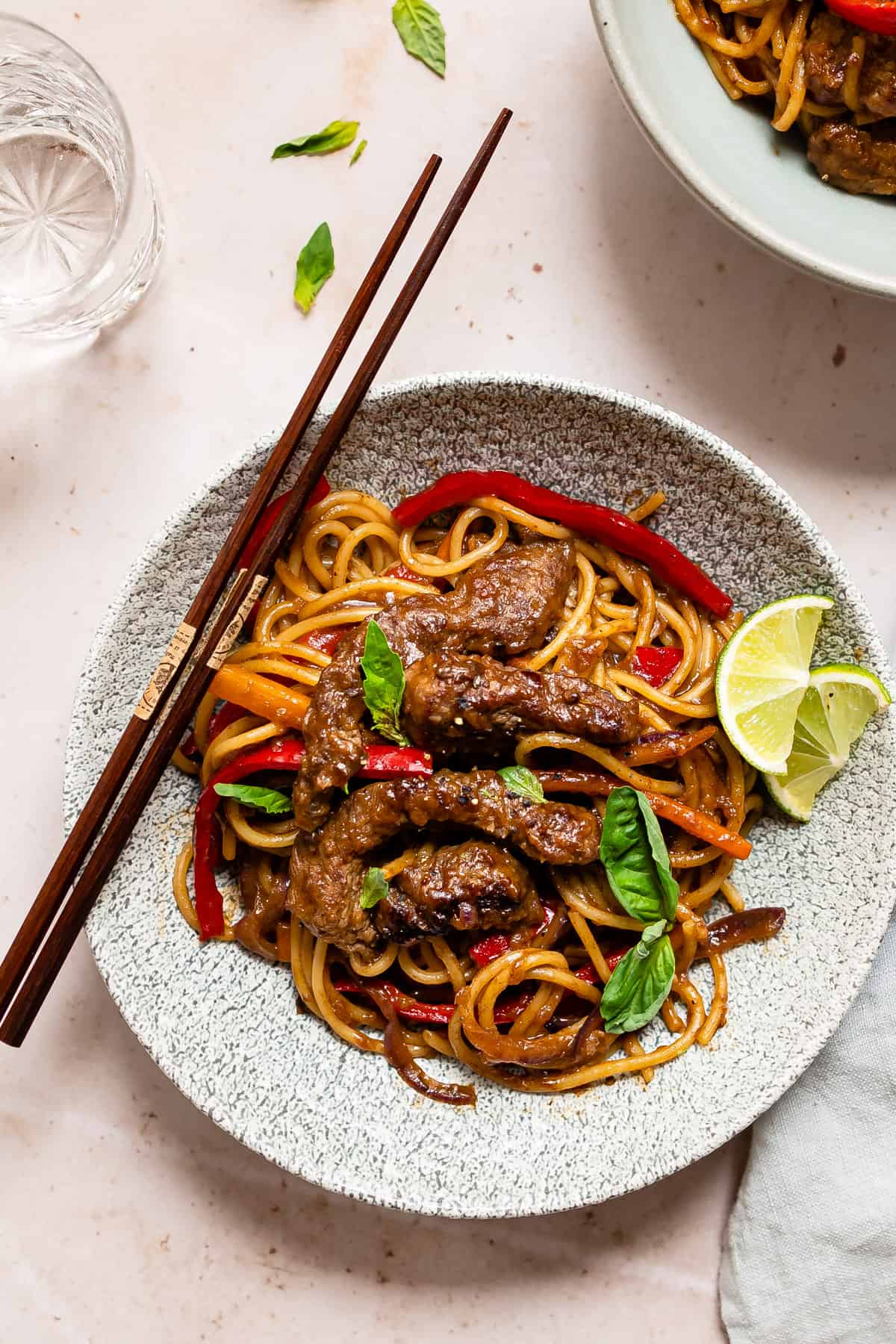 Beef in oyster sauce with noodles in a blue bowl