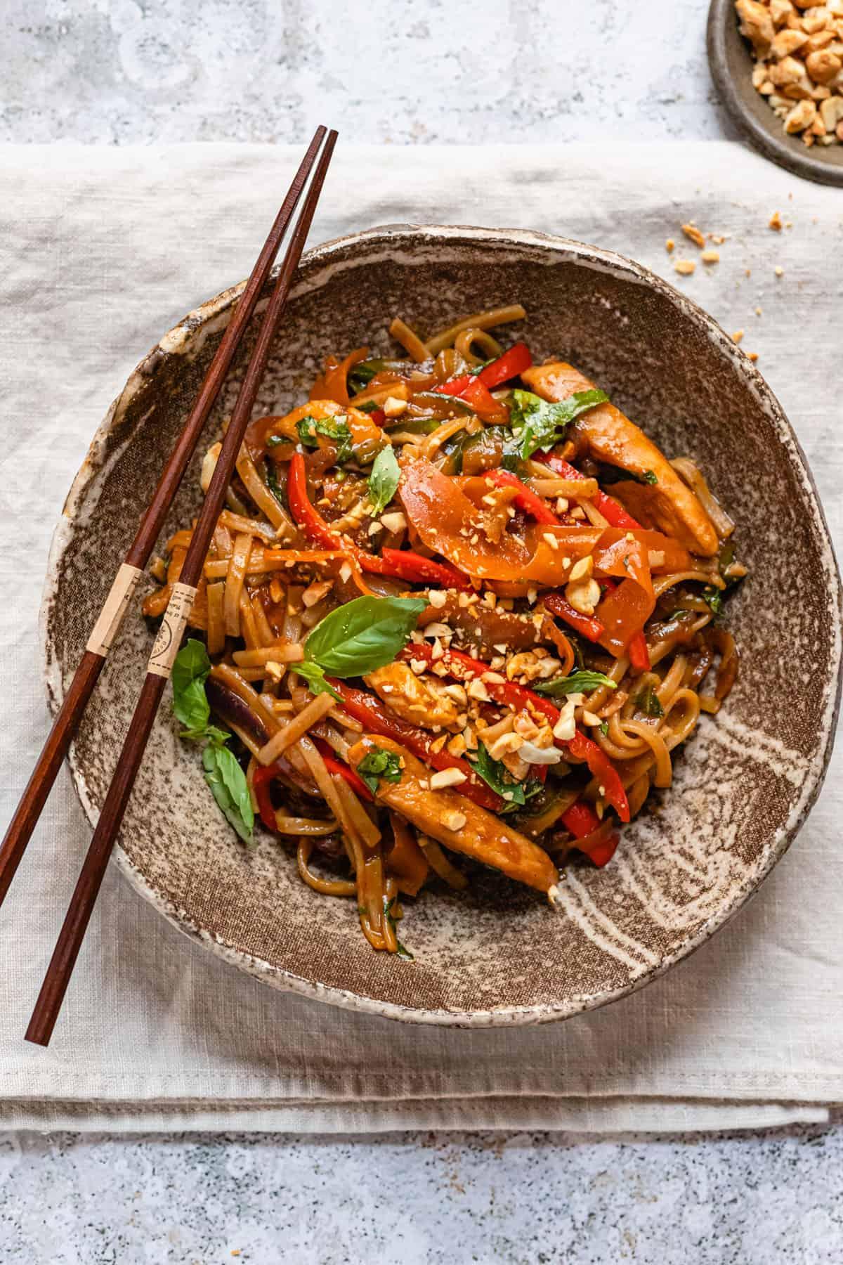 Thai drunken noodles with chopsticks