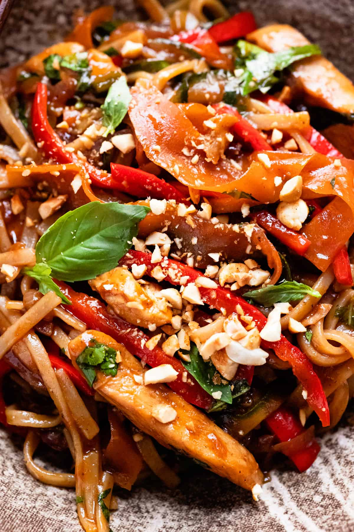 15 Minute drunken noodles with chopped peanuts. Close up.