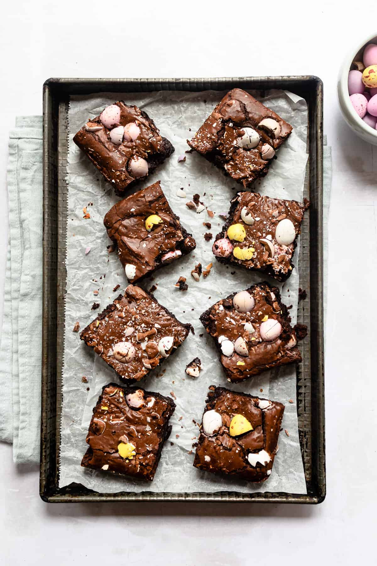 mini egg brownies on a baking tray
