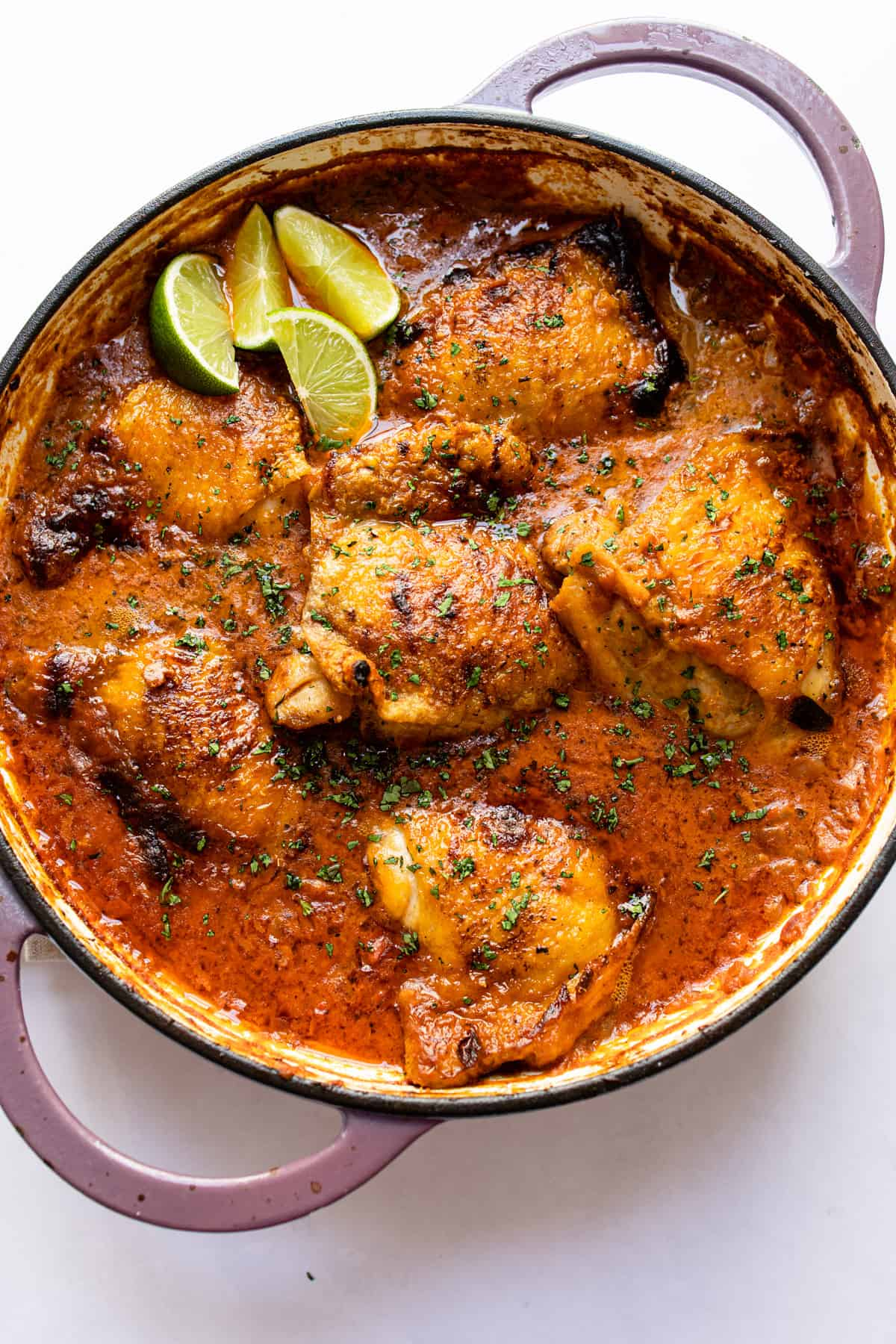 curry chicken thighs in a pot with lime wedges using only aldi ingredients