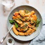 Creamy tomato chicken pasta in a green bowl- Aldi chicken recipes