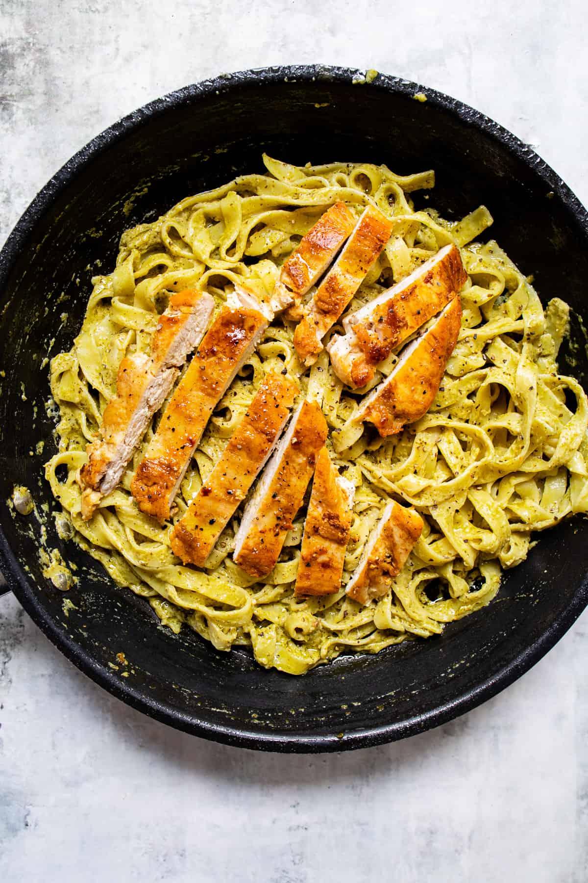 fried chicken over pesto pasta