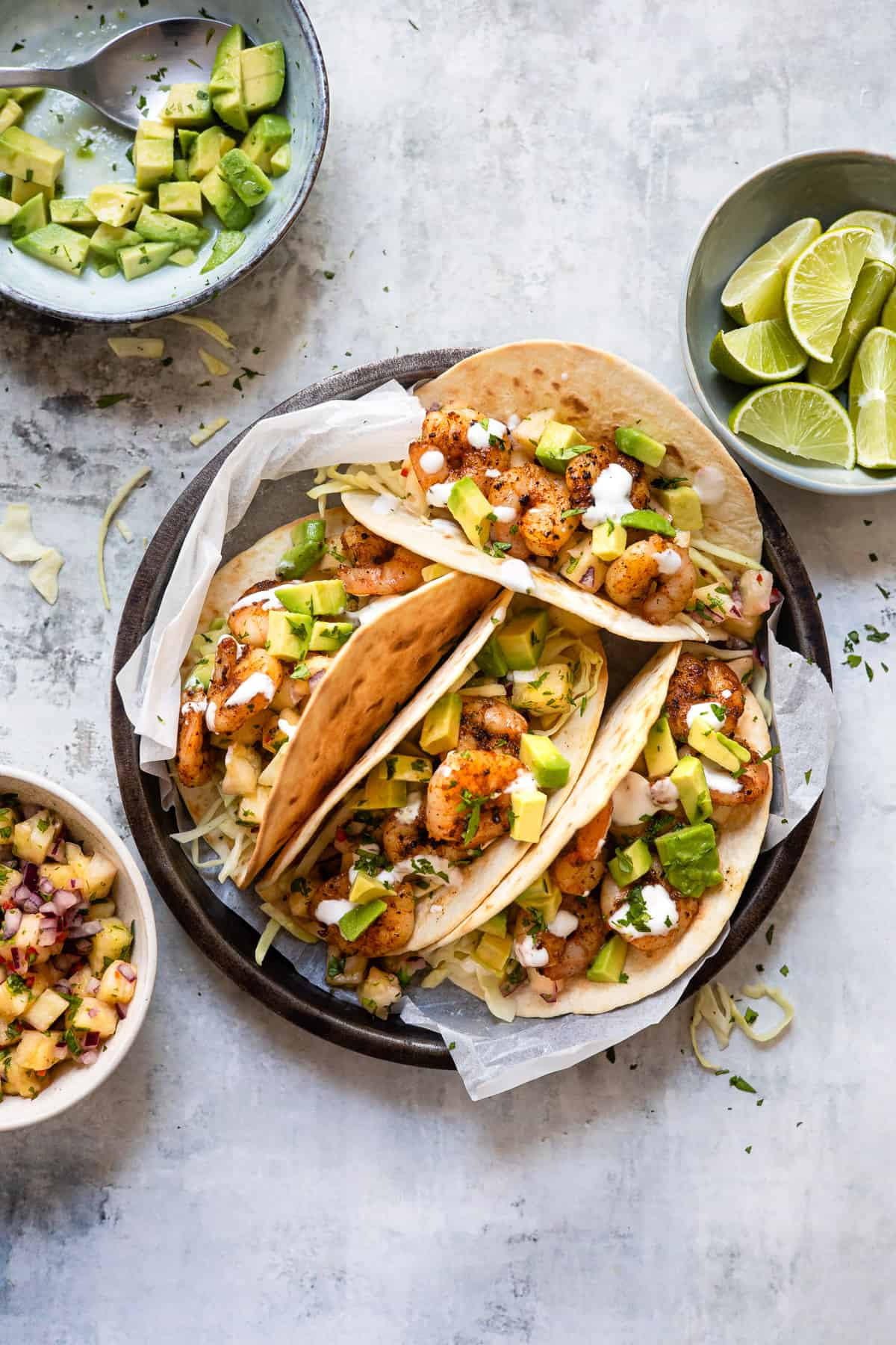 Crispy prawn tacos in a white table with pineapple salsa